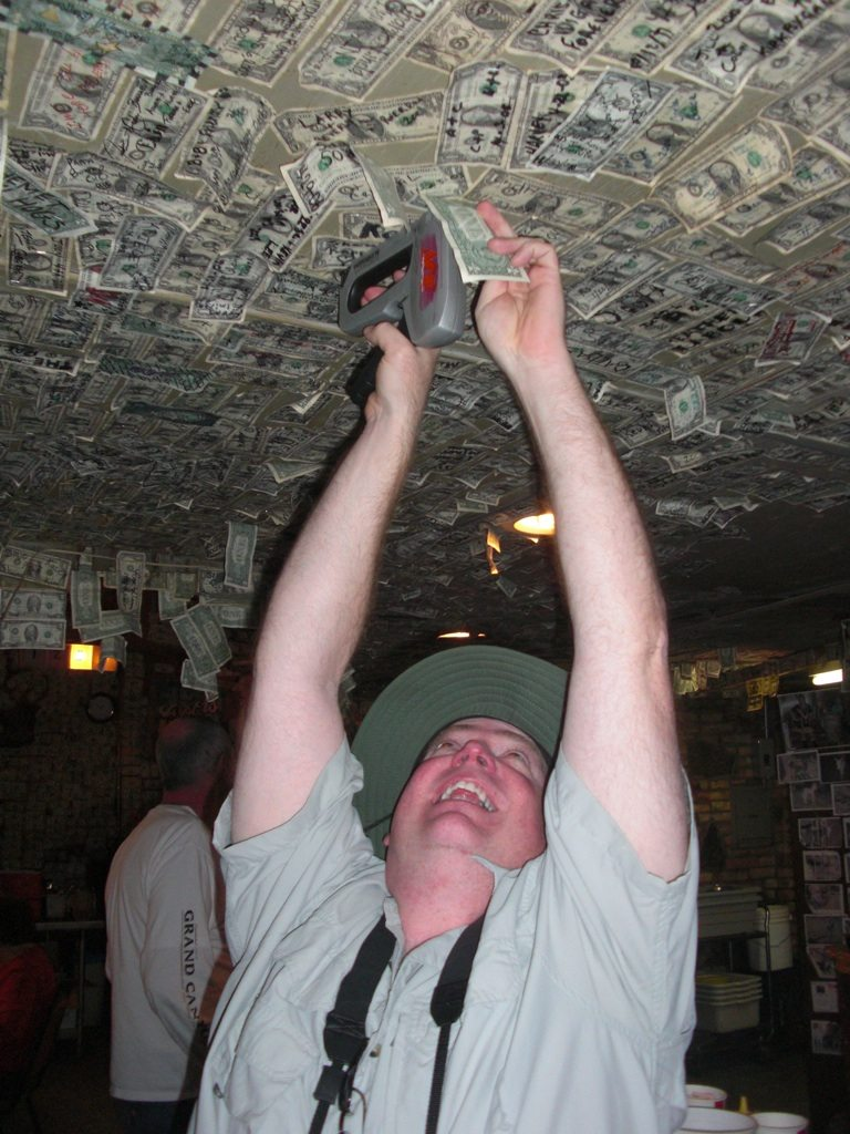 David Stapling Our Dollar on the Ceiling