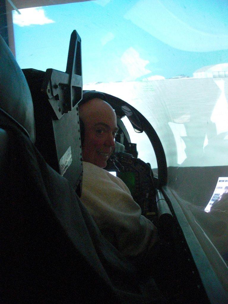 David in Pilot Seat Inside Top Gun Simulator
