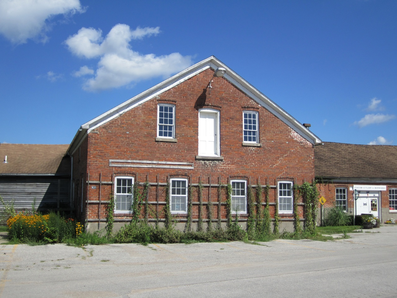 The Outside Of The Cutlery And Ironworks Building. Note The Traditional Amana Architecture With The Grape Vine Trellises.
