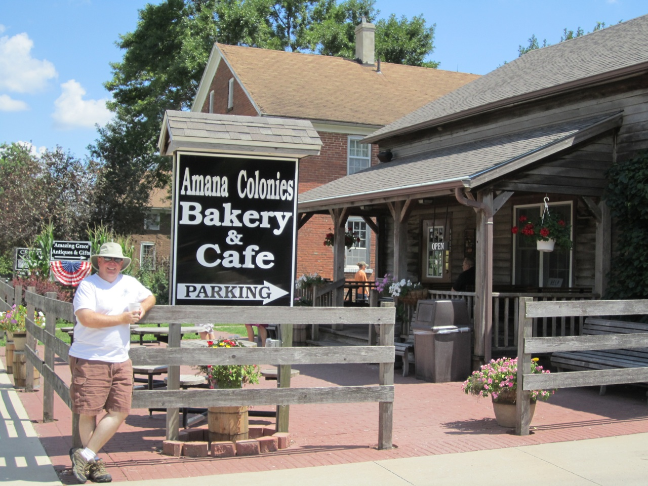 David Outside The Amana Bakery & Cafe.  Mmmmm...The Giant Cookies And Pasteries.