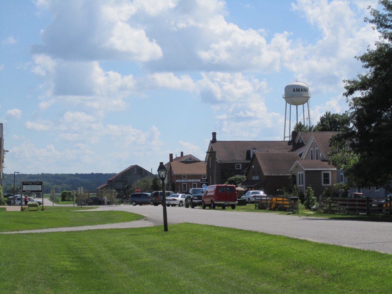 Amana, Iowa's Water Tower In The Background Of The Town.