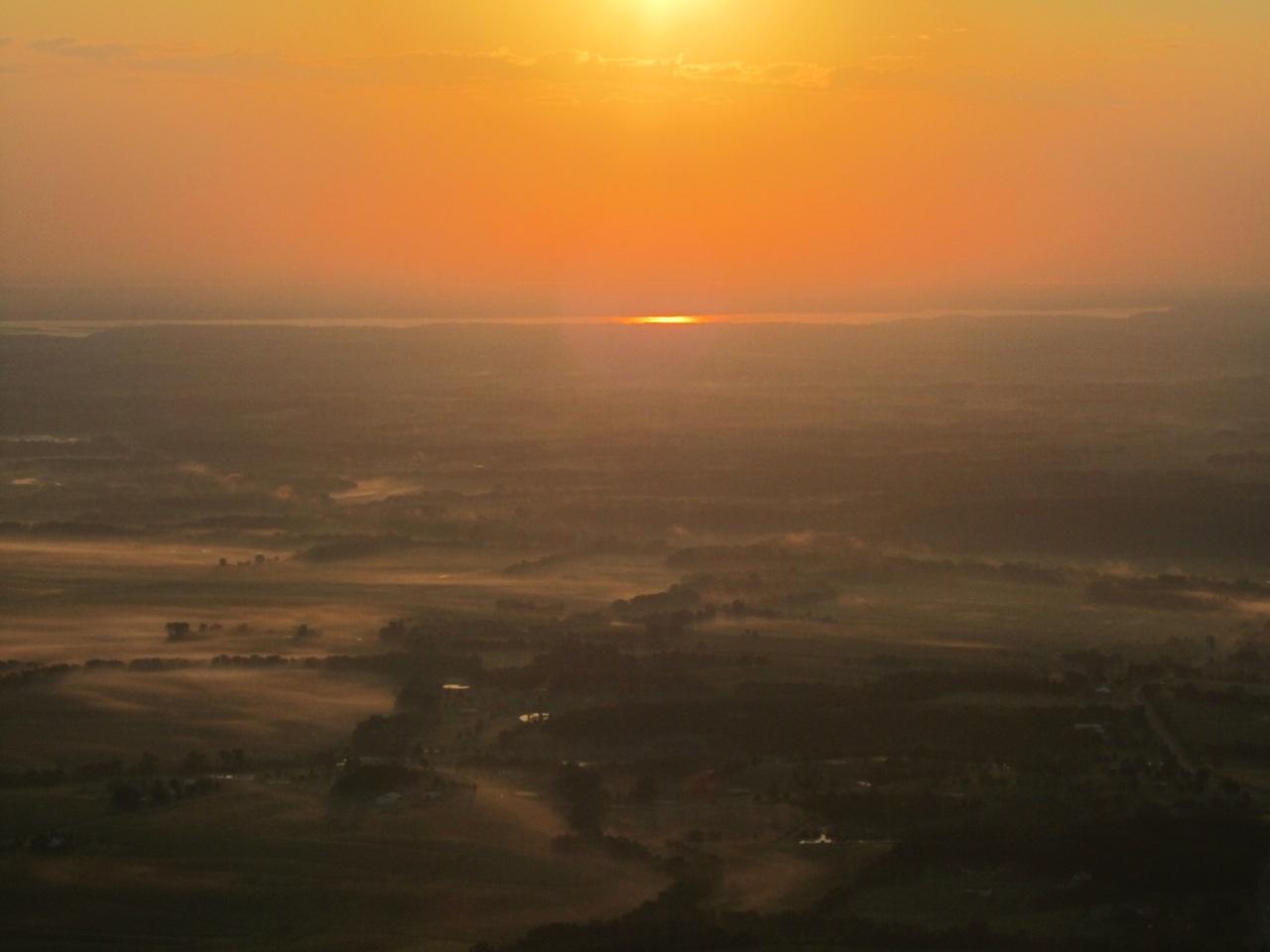 Sun Rising Over Iowa Fields