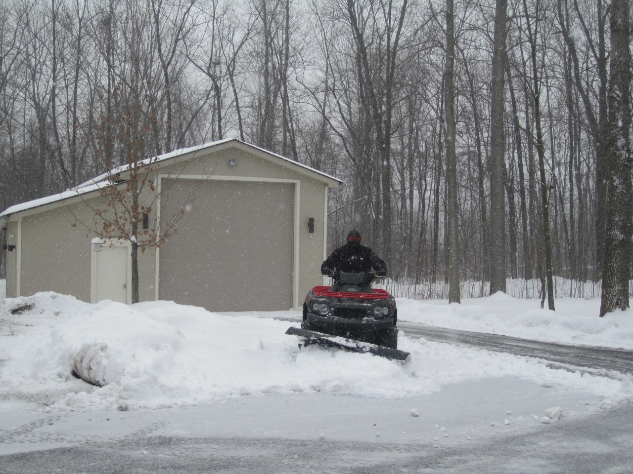 David Plowing The Snow In Our Driveway