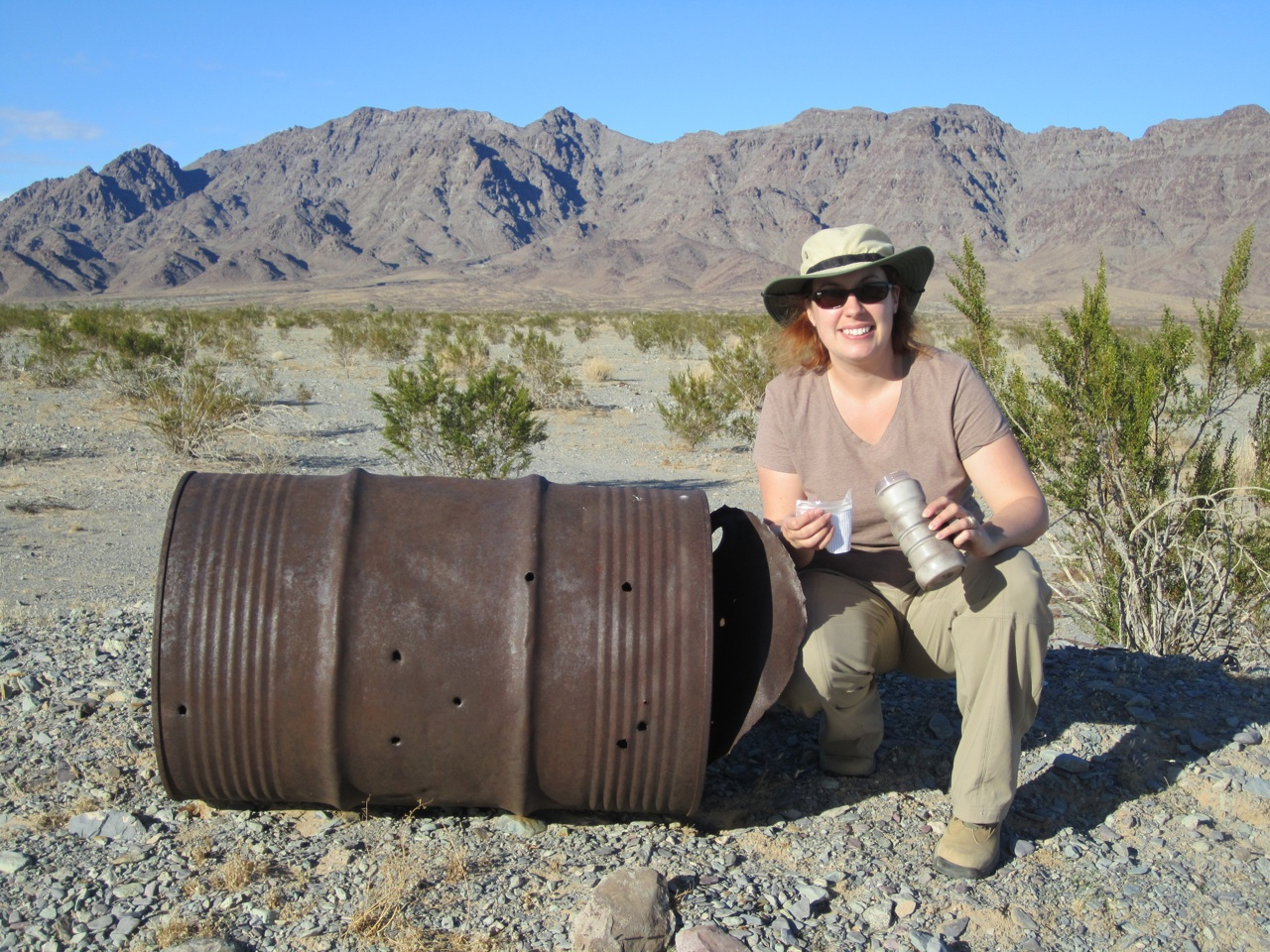 Brenda Finding A Cache In The Desert In An Old Rusty Drum