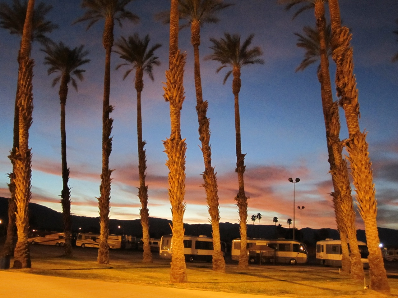 Sun Setting Behind The Mountains, At The Fairgrounds In Indio, CA