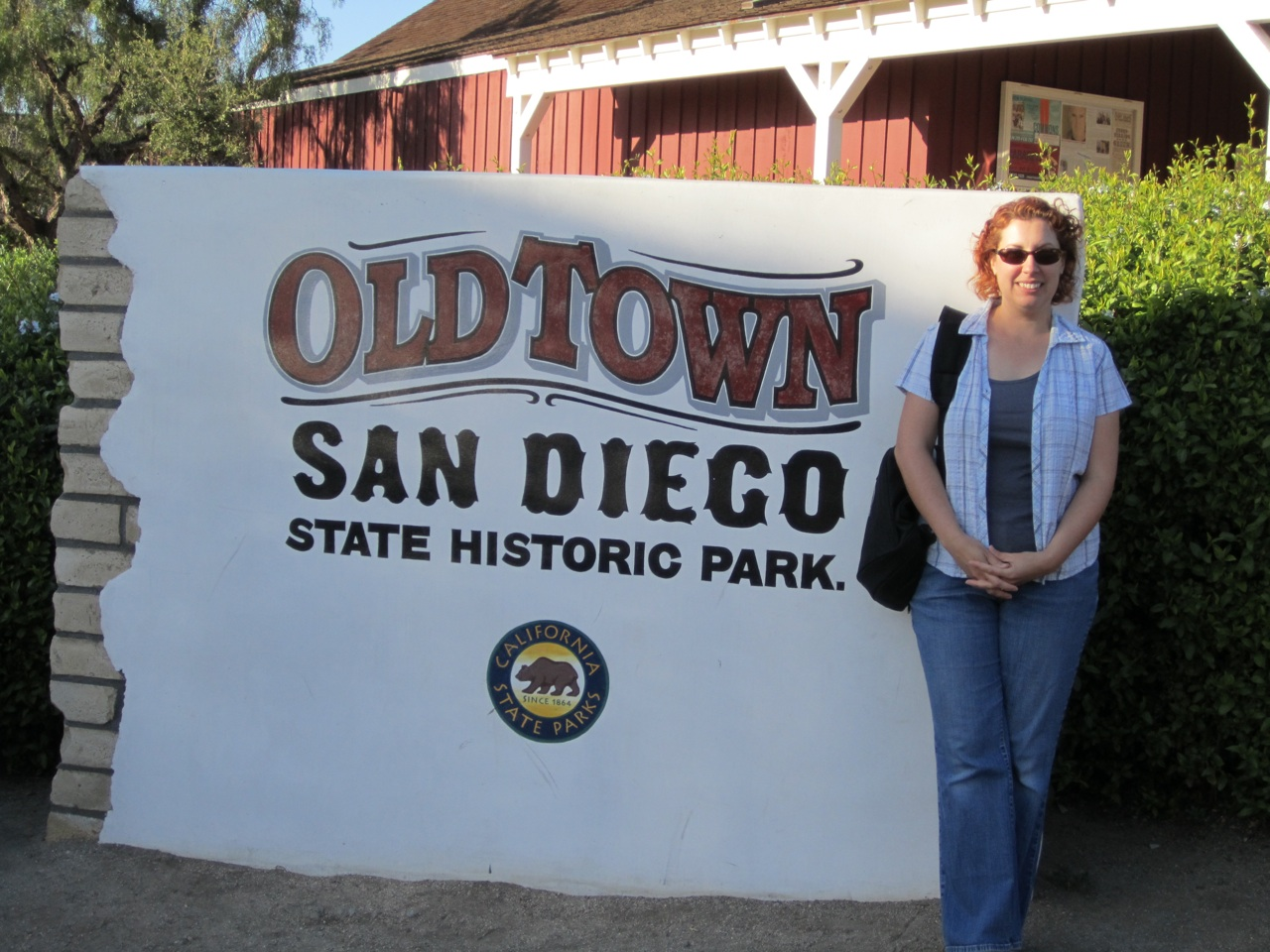 Brenda In Front Of The Old Town Sign