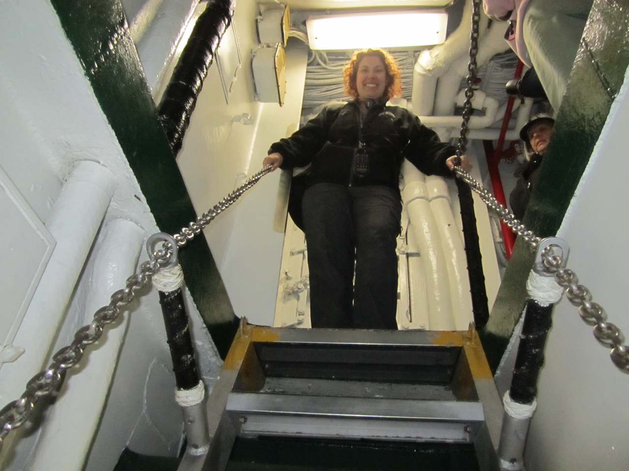 Brenda Looking Down A Narrow Staircase Aboard The USS Midway