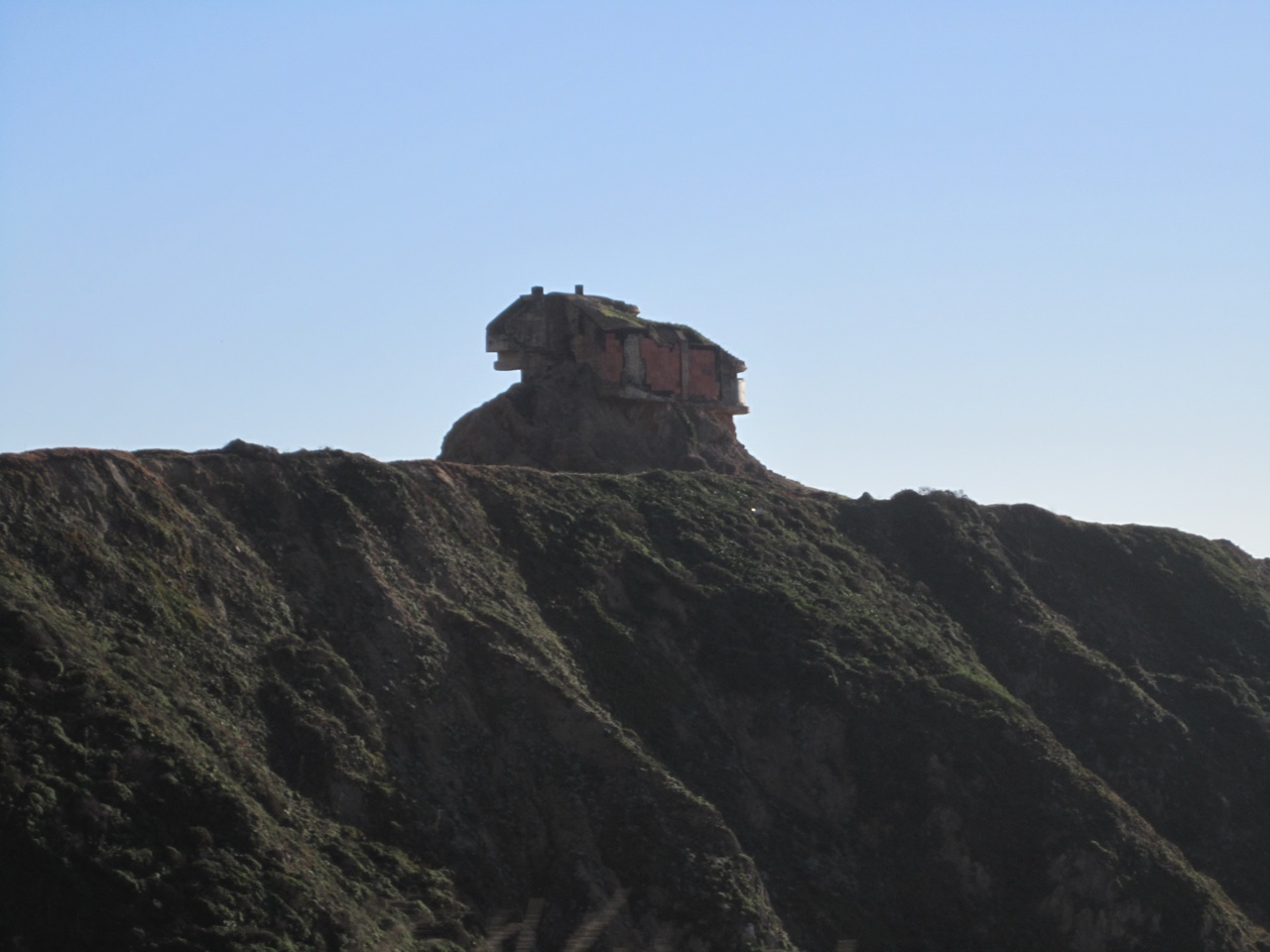 A House On A Hillside, On Highway 1, Taken By Erosion.