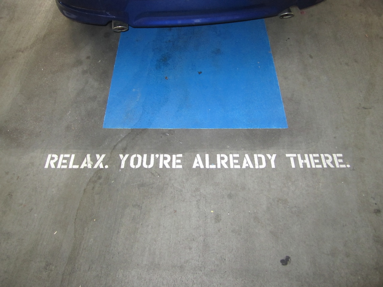 A Parking Spot In A Garage With An Inspirational Saying Painted On It.  Each Spot Had A Different Saying.