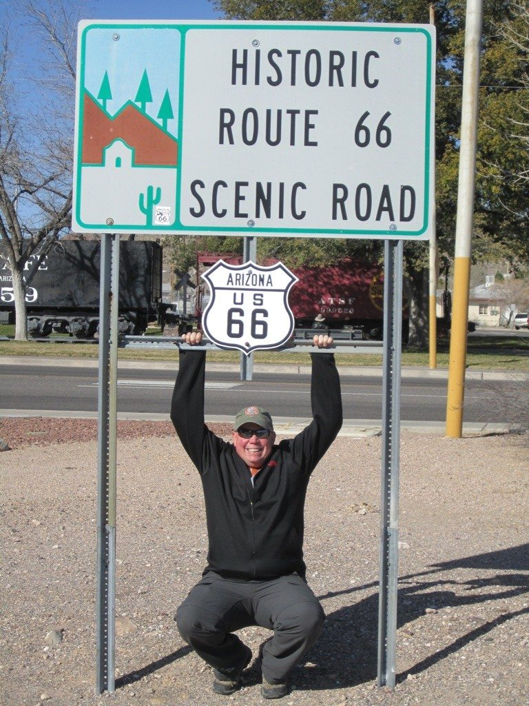 David Hanging Off A Route 66 Sign In Kingman, AZ