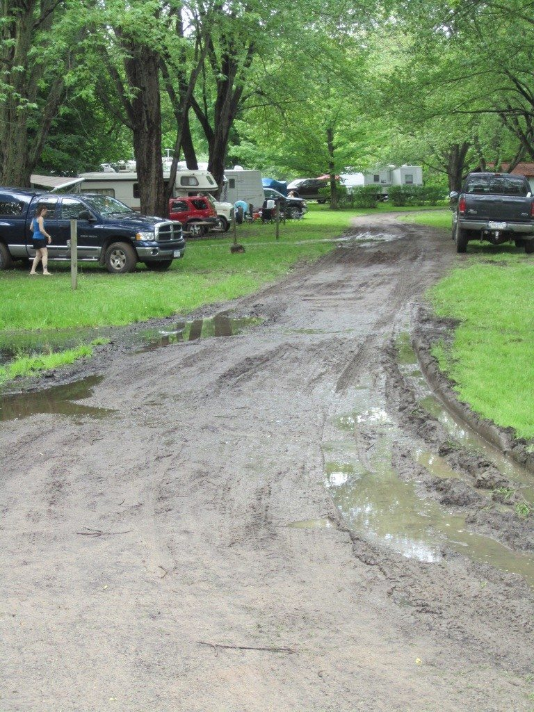 Muddy Streets And Water Surrounding Some Campers