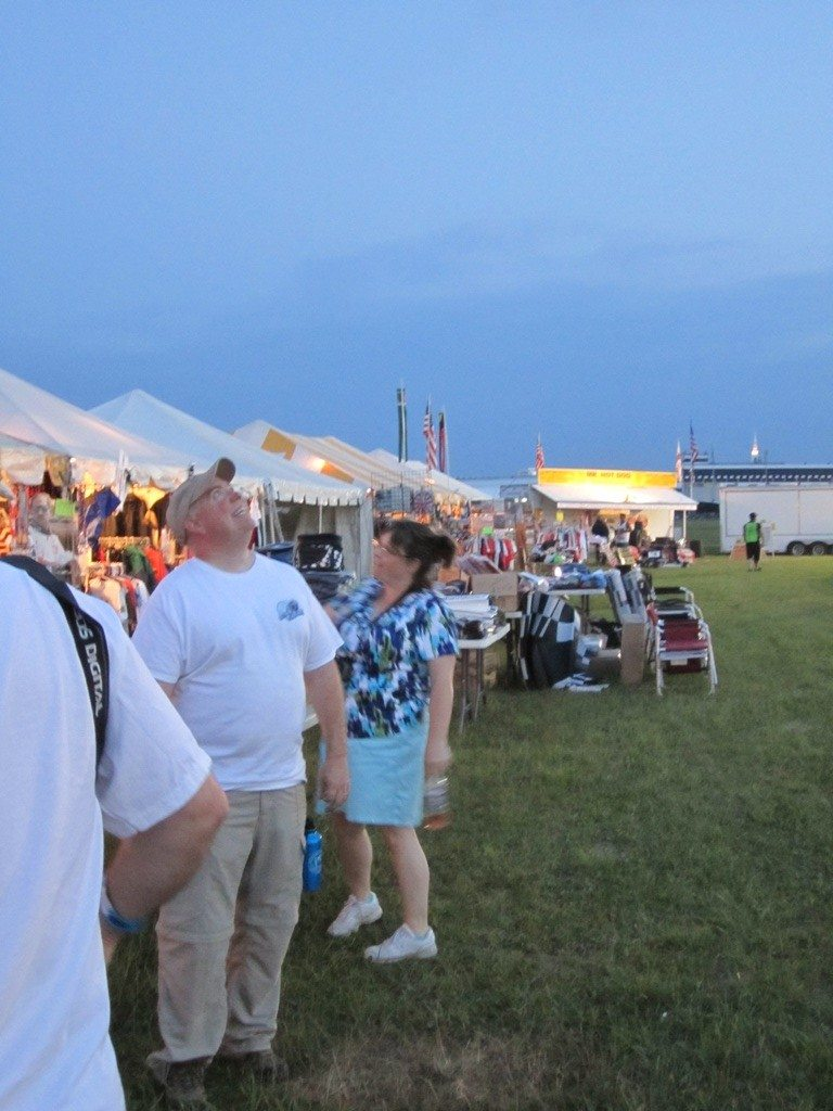 Checking Out The Vendors In The Infield.  David Is Watching A Fire Lantern Fly Up Into The Sky.