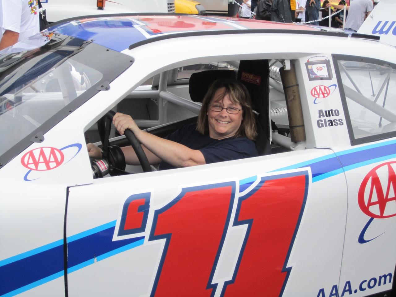 Lynn Behind The Wheel Of A Nascar Race Car