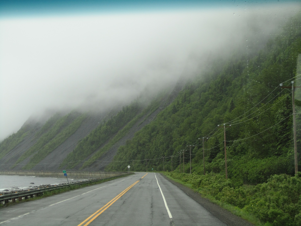 More Foggy Road Between Coastline And Mountains