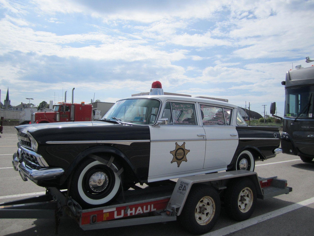 A cool Sheriff's car from the Andy Griffiths show on a trailer.