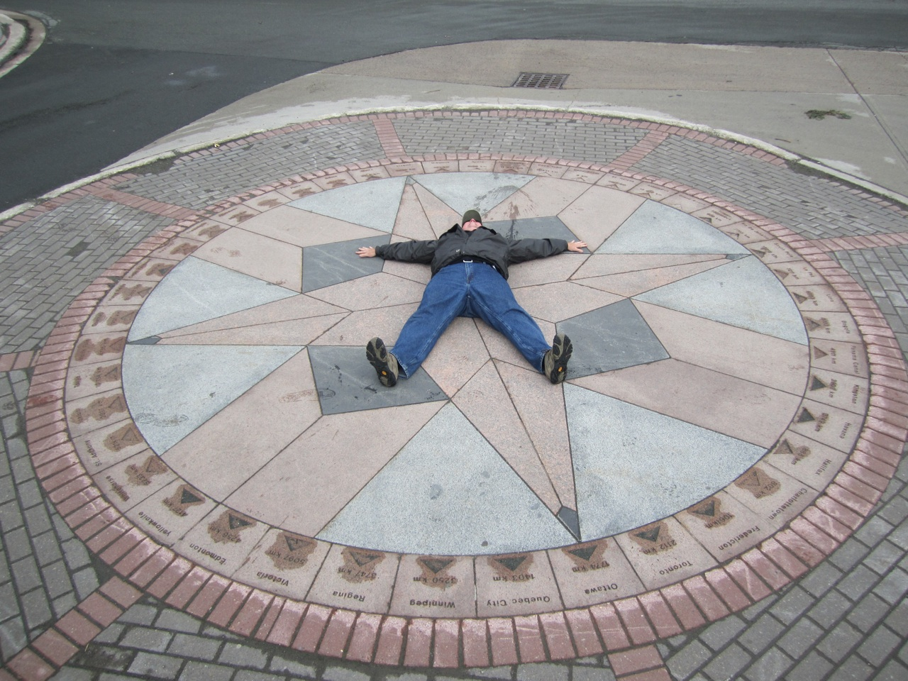 David Laying On Mile Marker 0 In St. John's, Newfoundland