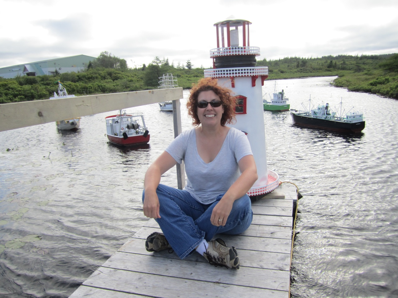 Brenda Sitting In Front Of The Miniature Lighthouse And Boats