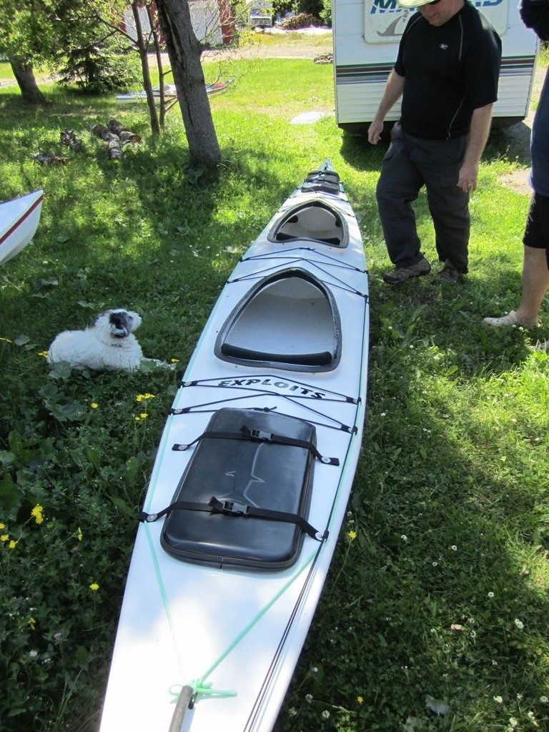 David Talking To Lindy About This Kayak In His Yard.  This One Was Sold And Waiting To Be Delivered.