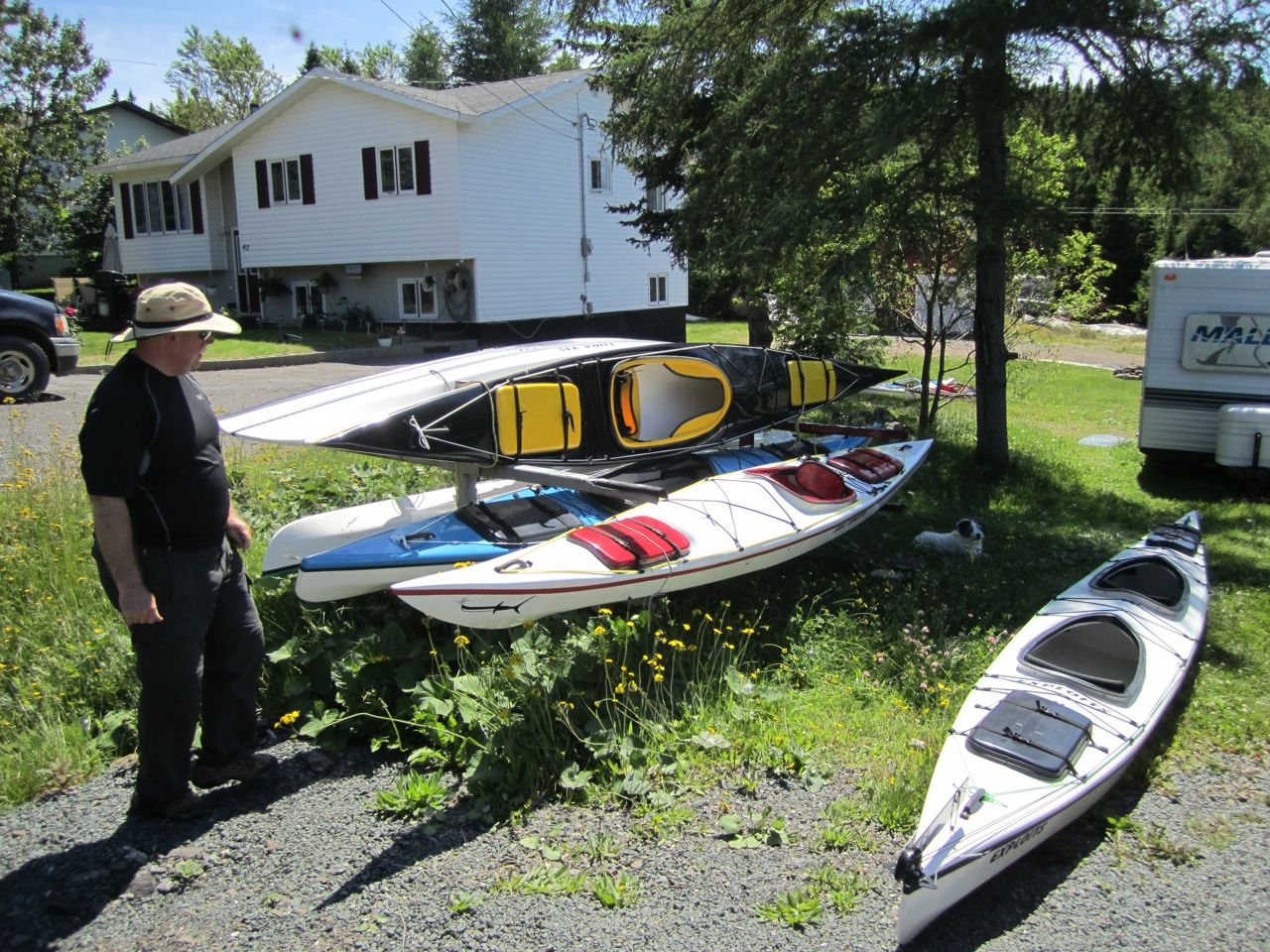 David Checking Out The Kayaks In Lindy's Front Yard.