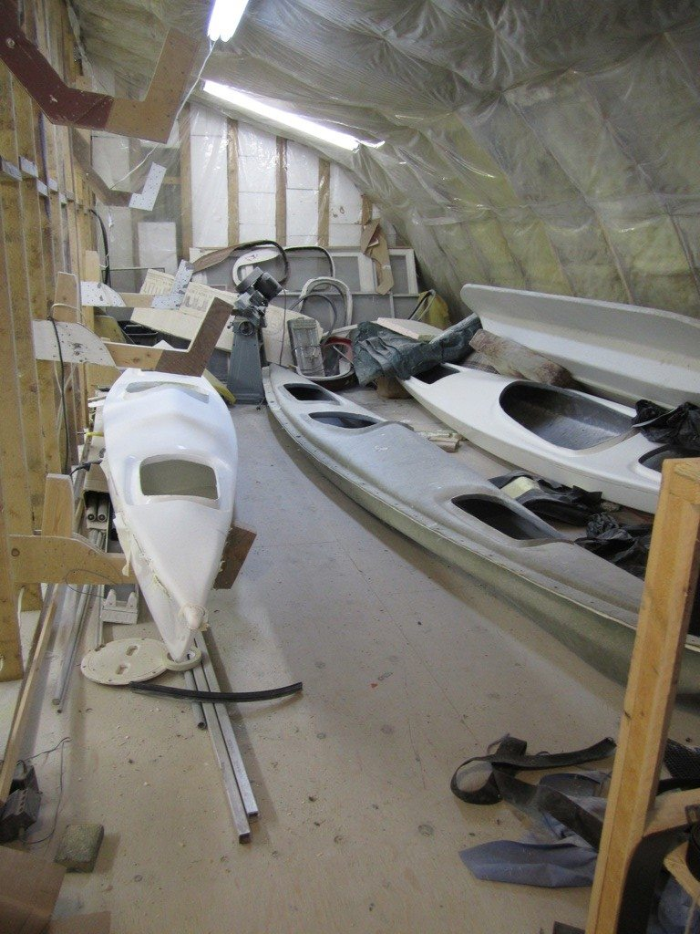 Kayaks Waiting For Their Finishing Touches