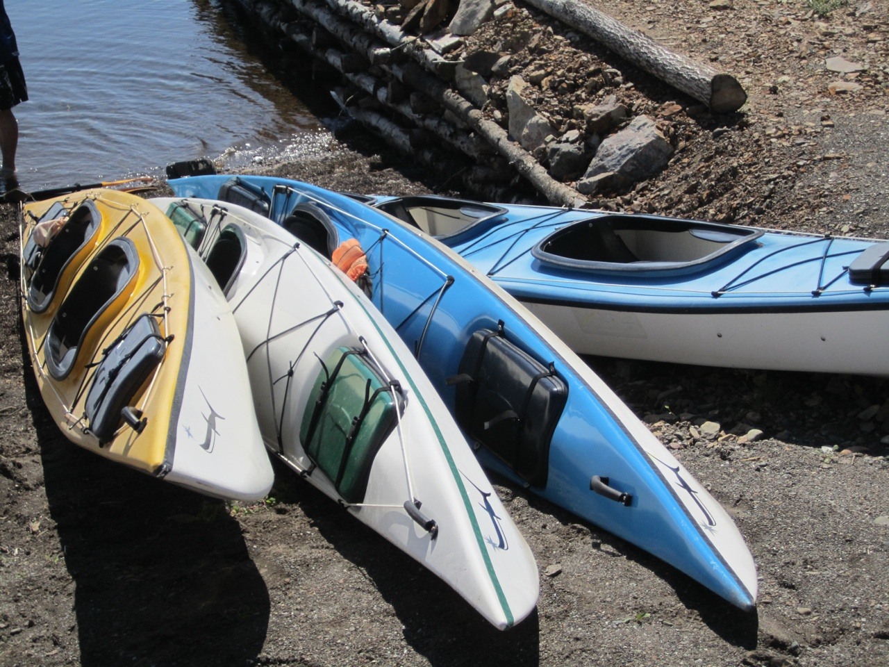 Sea Knife Kayaks Waiting For Someone To Take Them Into The Water.