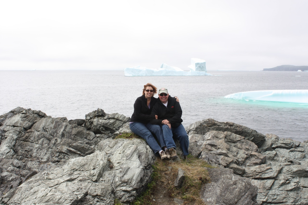 David And Brenda At Goose Cove Bay With The Icebergs In The Background