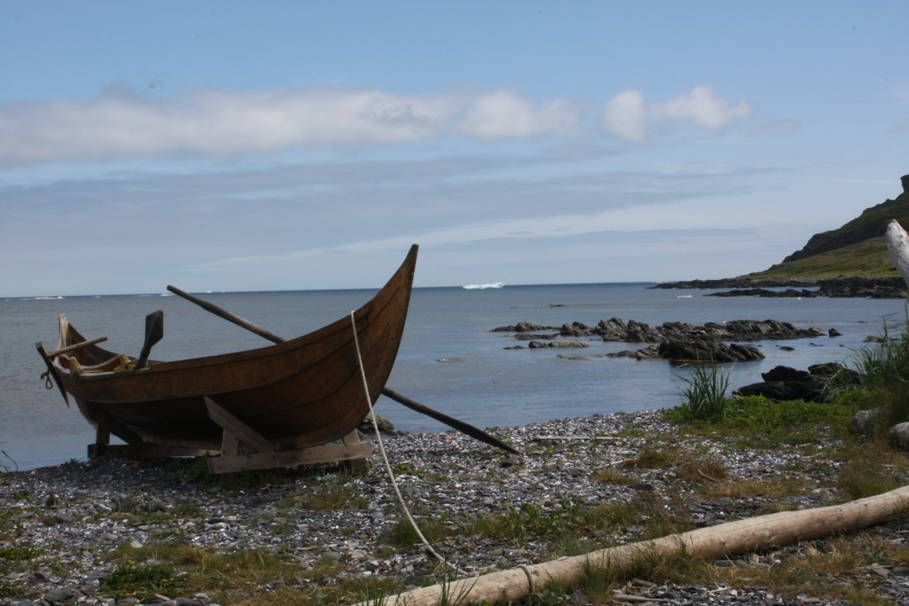 Viking Village At L'Anse aux Meadows, Iceberg In The Background.