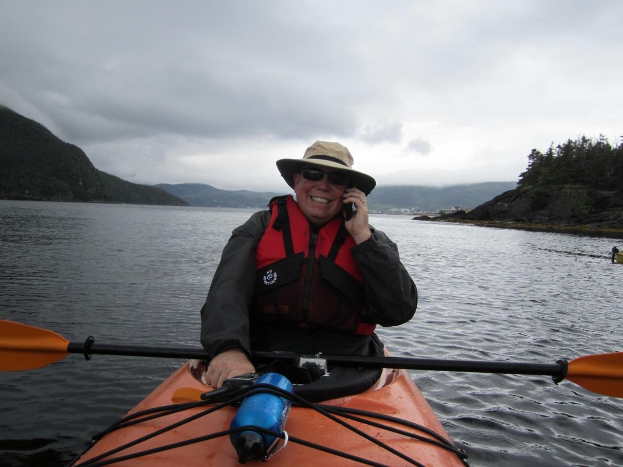 David Taking A Call On Bonne Bay While Kayaking