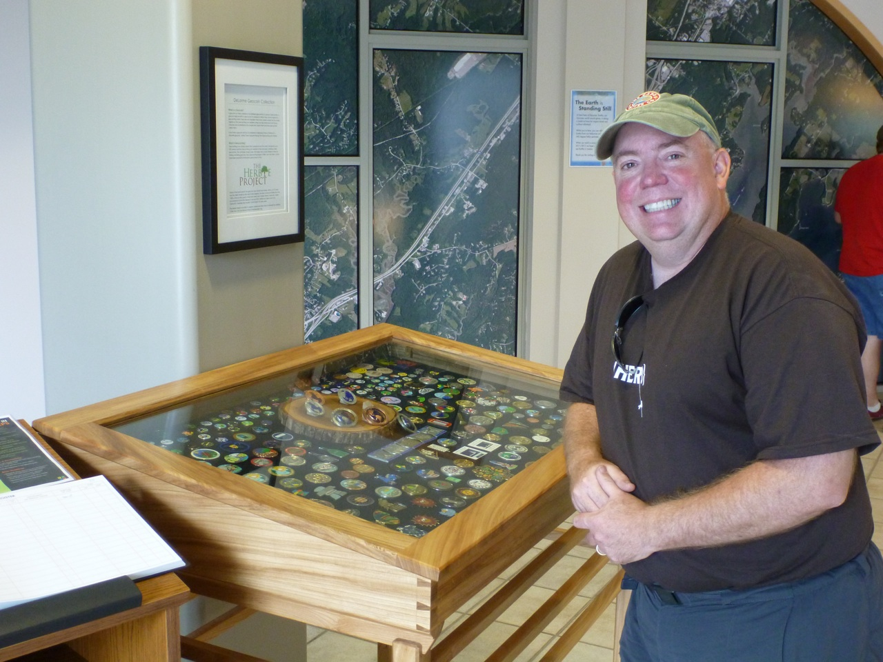 David Checking Out A Case Filled With GeoCaching Coins