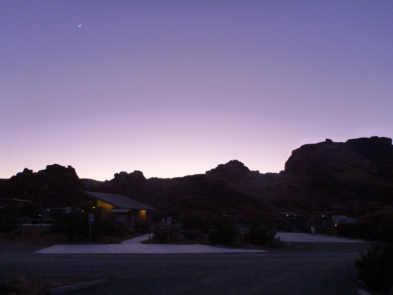 The Sun Setting Behind The Mountains At The Valley Of Fire State Park Campground