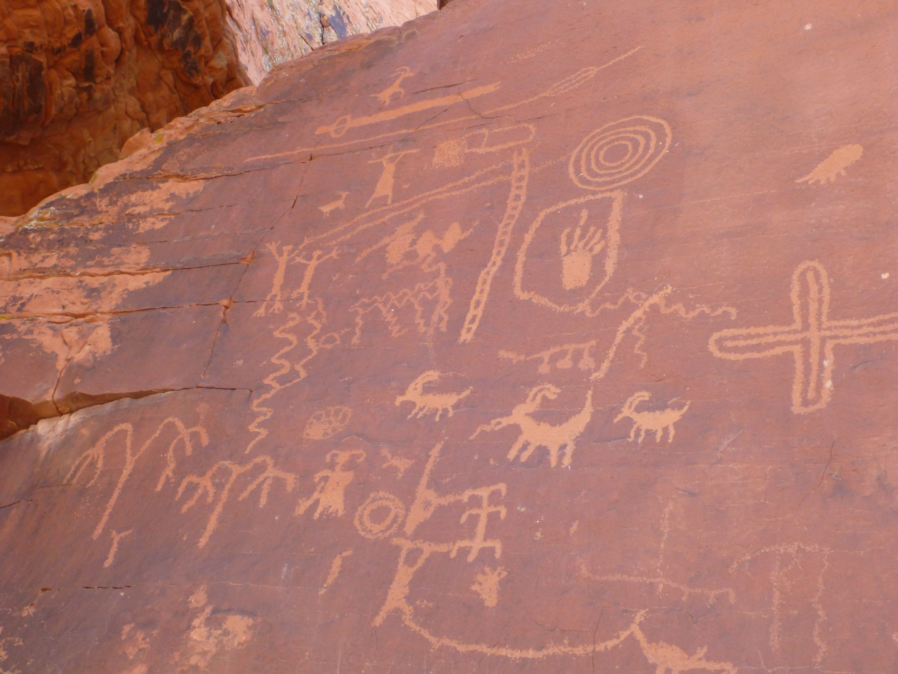 Petroglyphs On The Side Of The Red Rock Sandstone