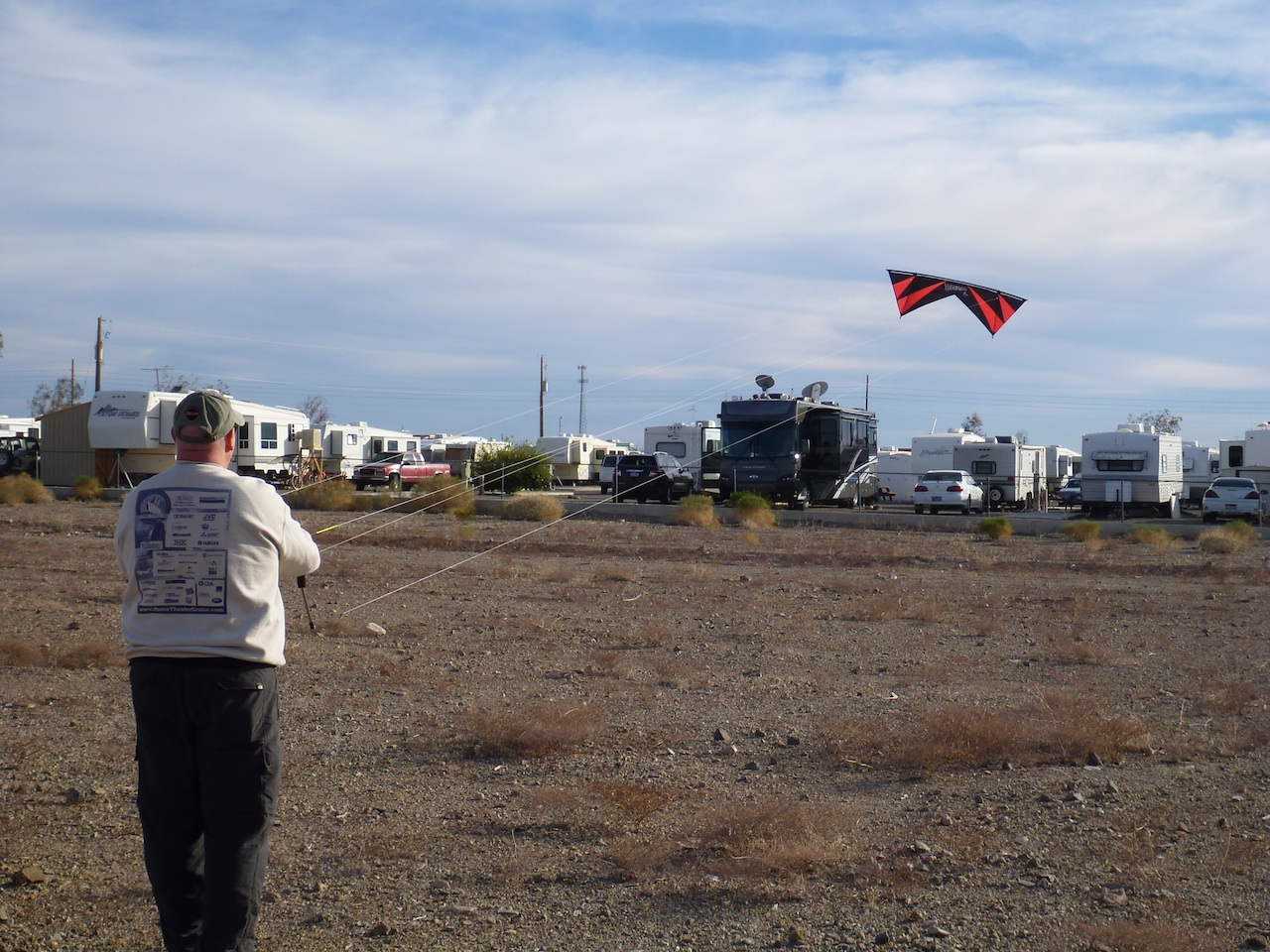 David Flying His Stunt Kite.  Our Coach In The Background.