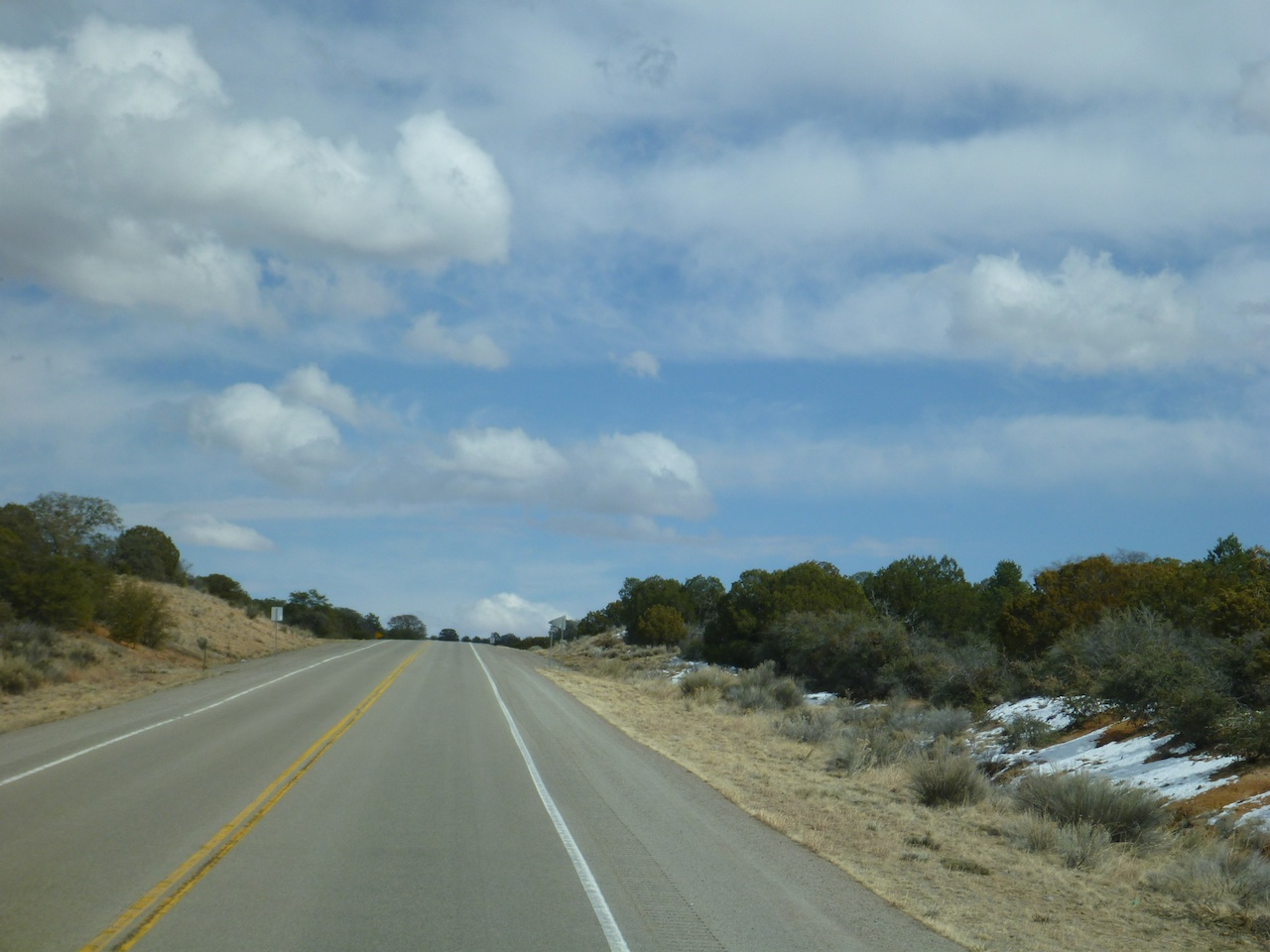 Climbing In Elevation, Heading Towards Silver City.  Yup...That's Snow On The Ground.