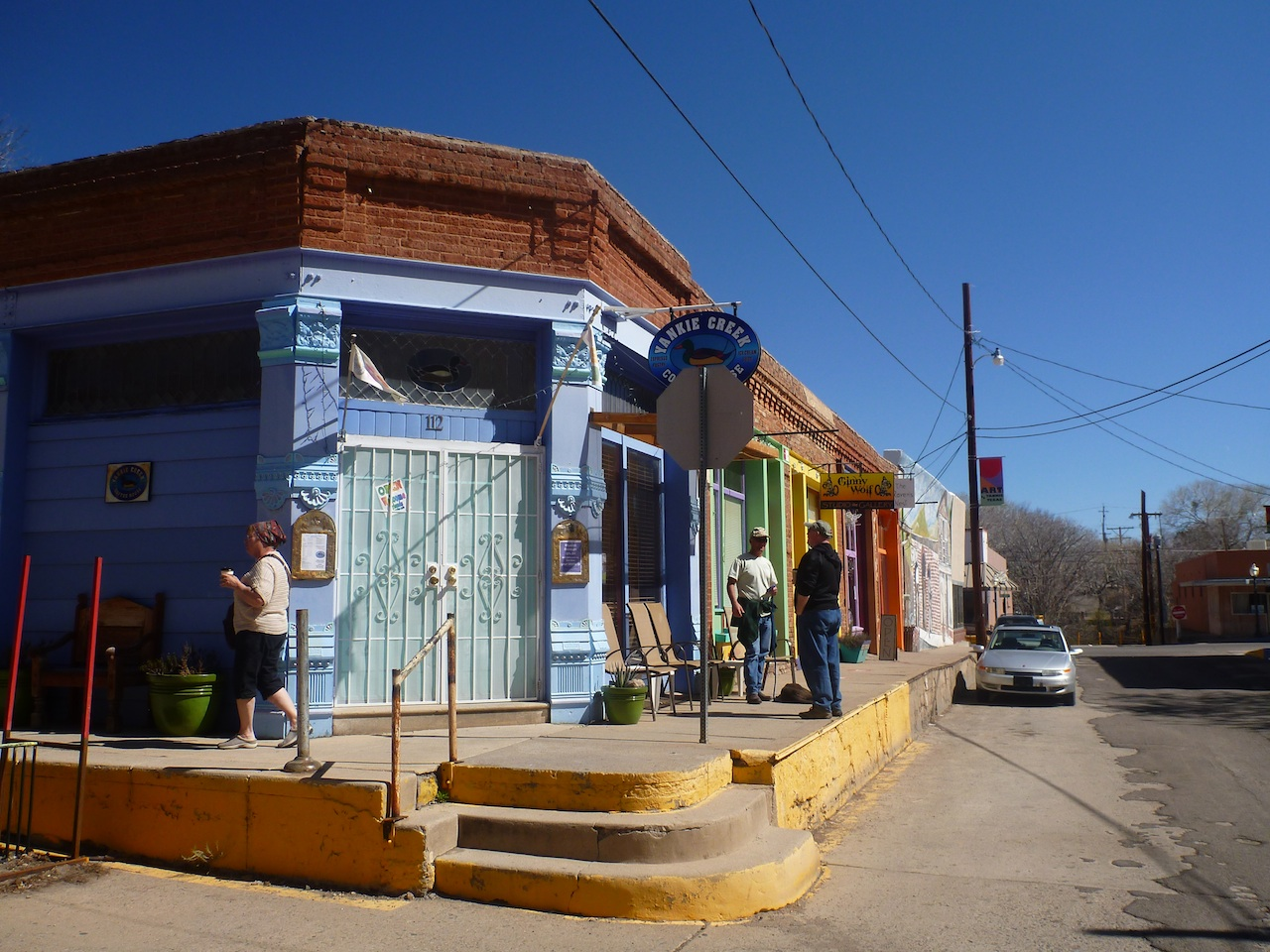 A Coffee Shop On The Corner.  Note The High Sidewalks To Accommodate The Water Flow.