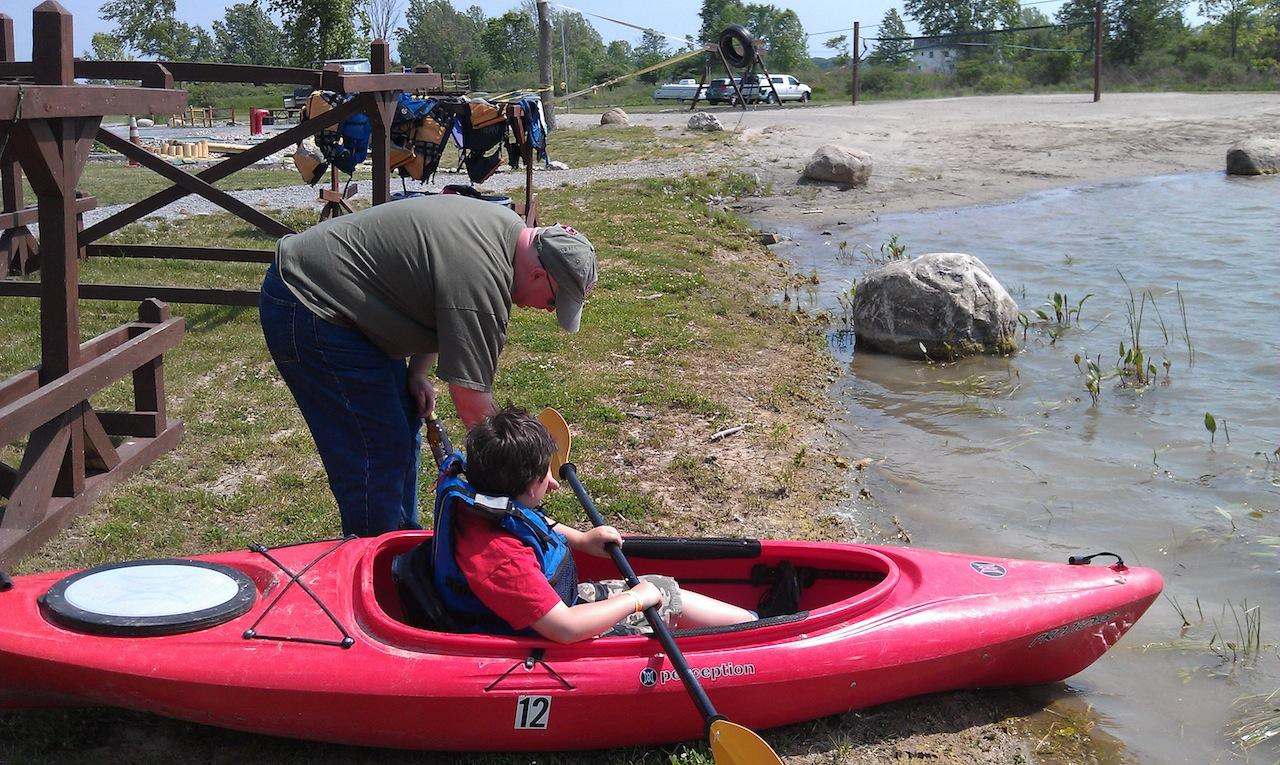 David Helping Michael Into The Kayak