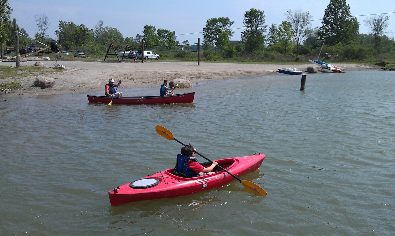 Kayaking And Canoeing On The Lake At The Campground