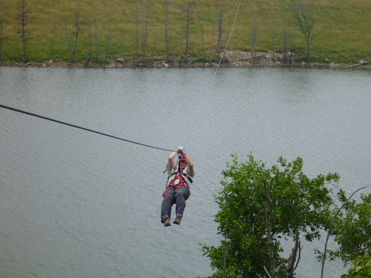 David Ziplining Over A Lake At The Wilds