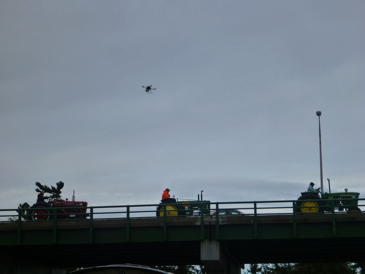 The Quadcopter And Tractors On The Bridge