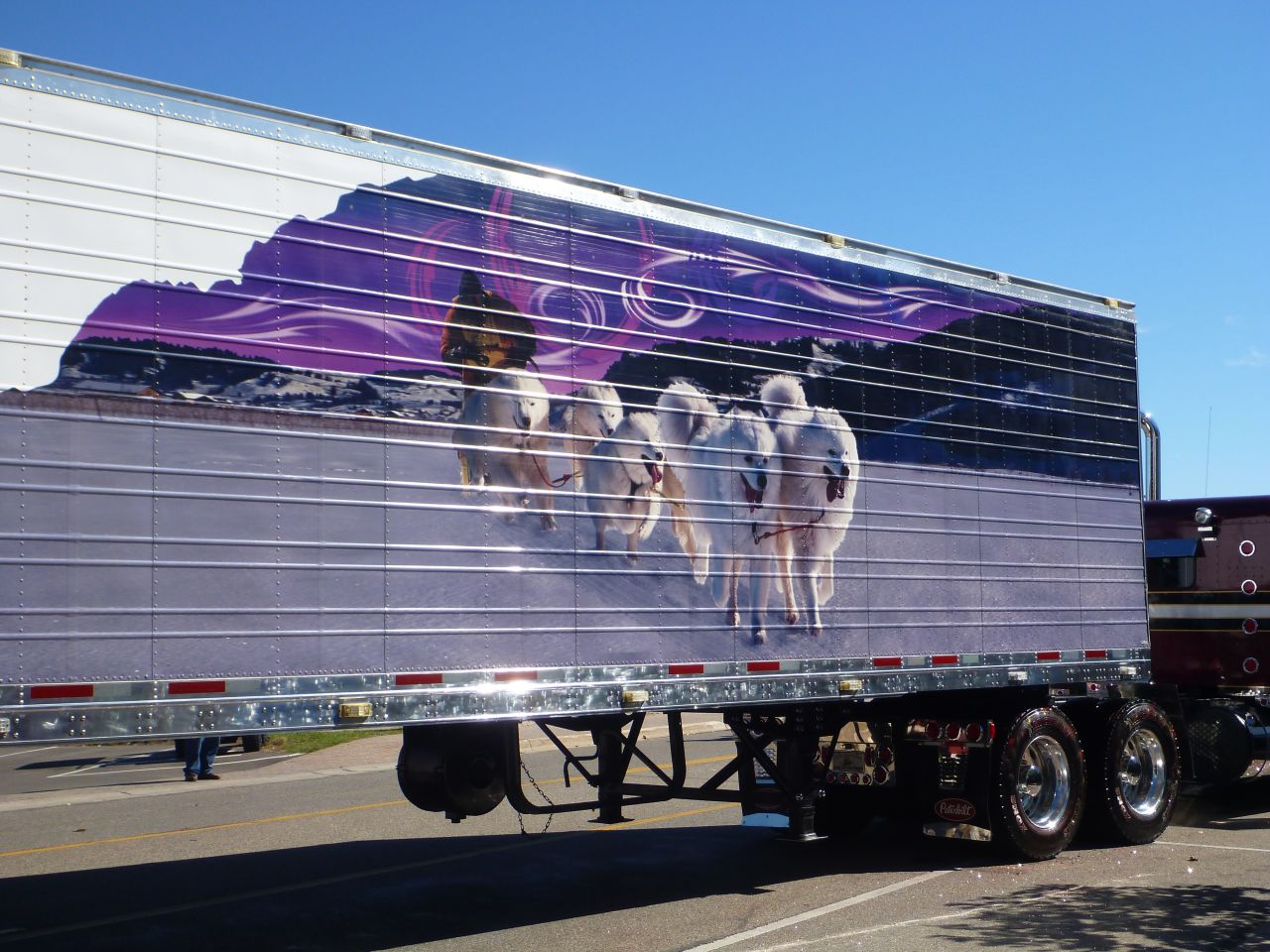 Sled Dogs Painted On The Side Of A Trailer.