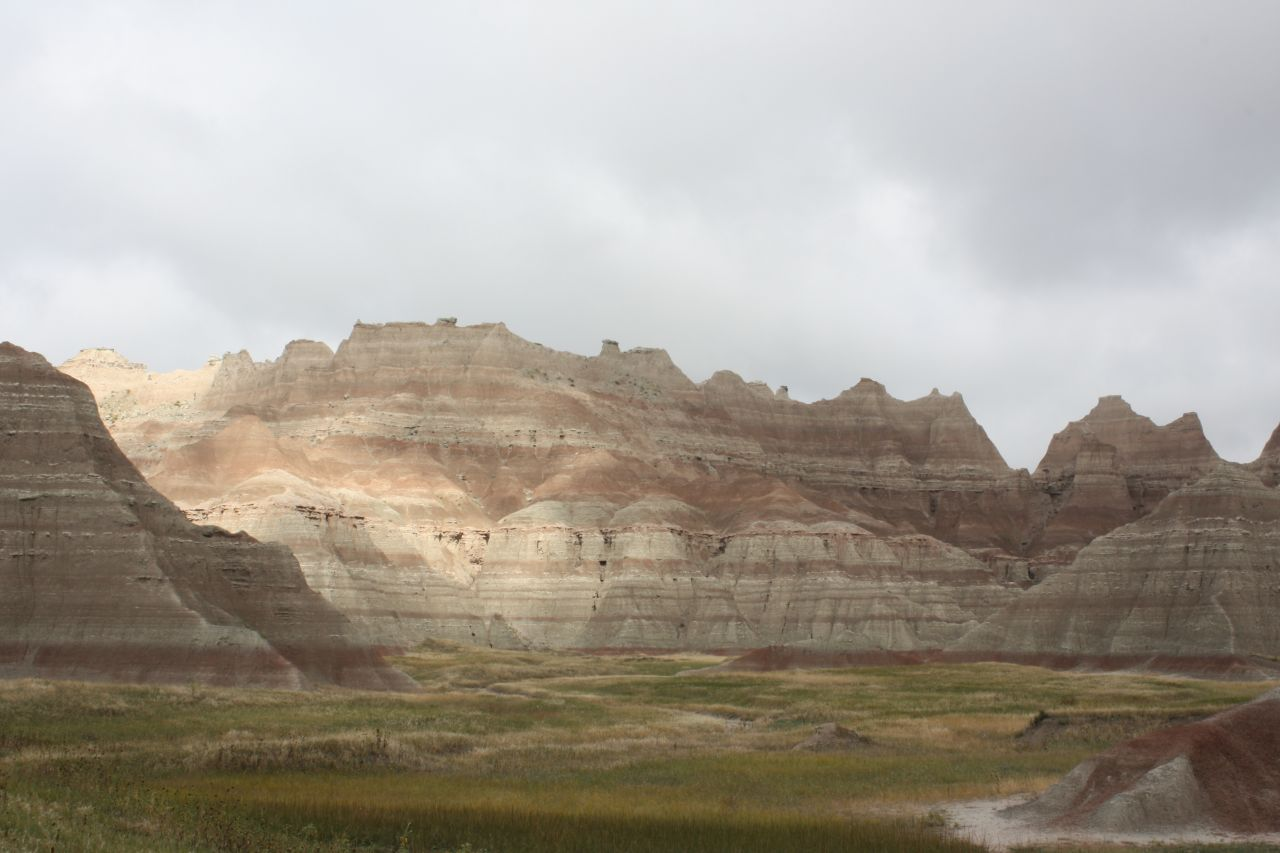 The Sun And Clouds Dance On The Badlands Peaks