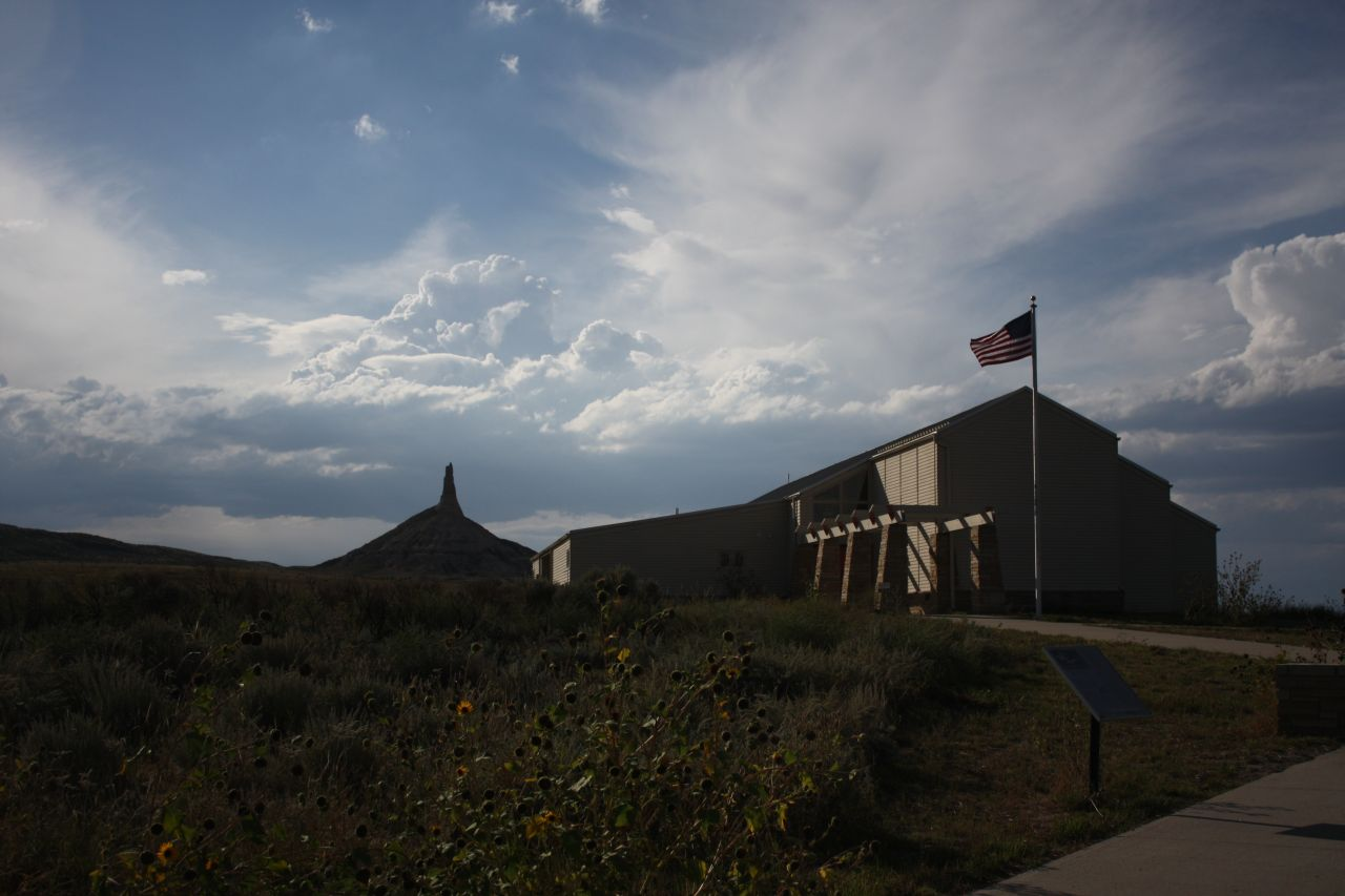 The Visitor's Center With Chimney Rock In The Background