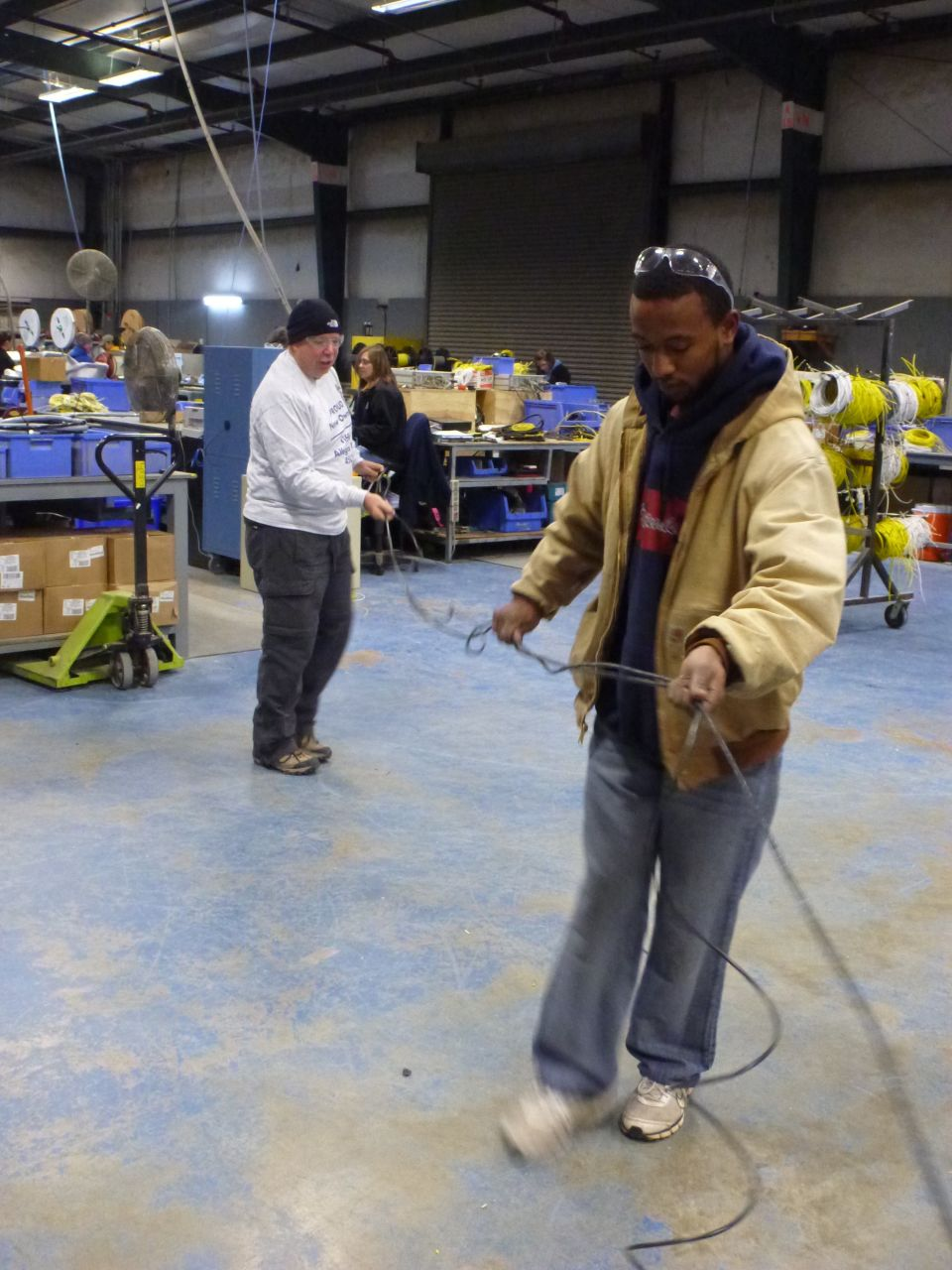 David Working Along Side Chris Running Wire