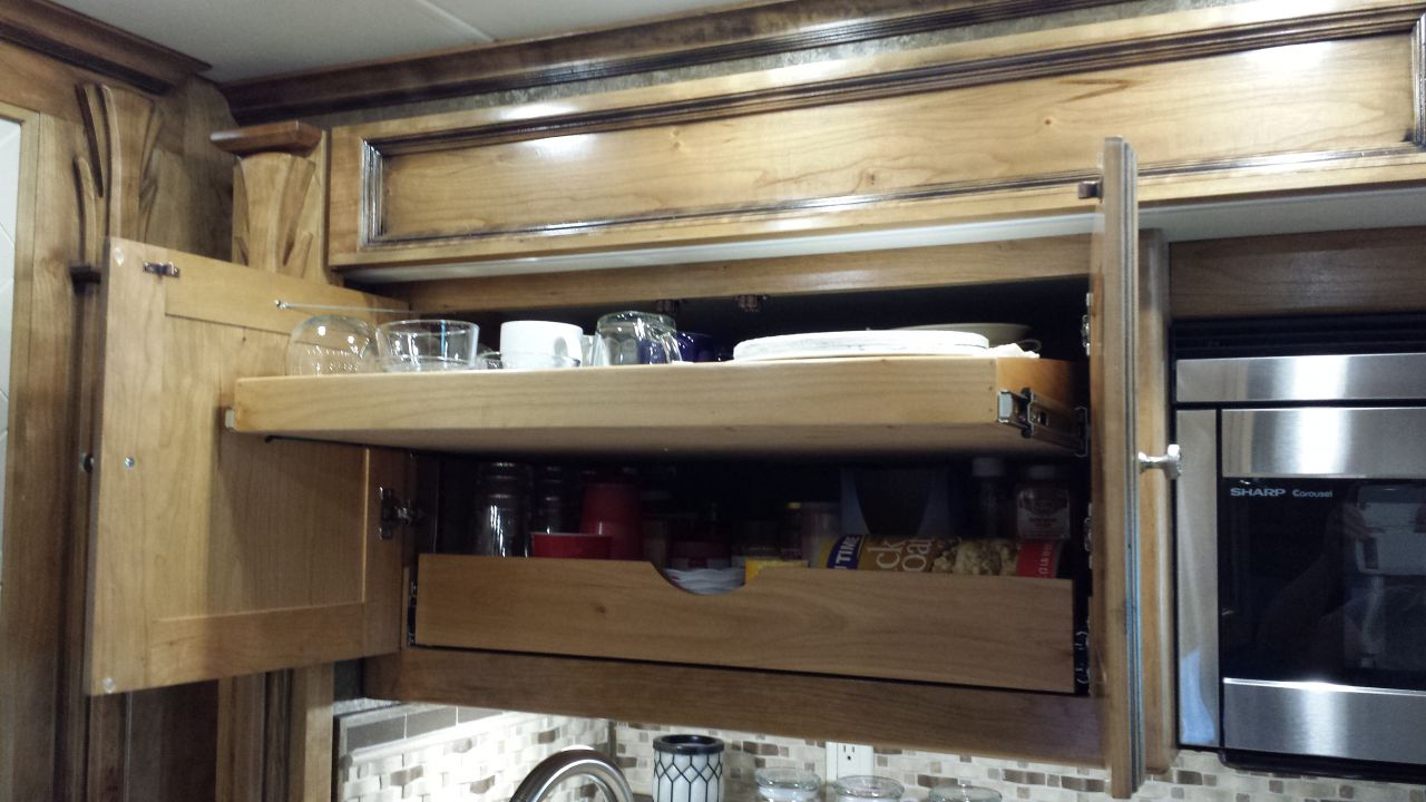 Top pull out shelf added above sink.