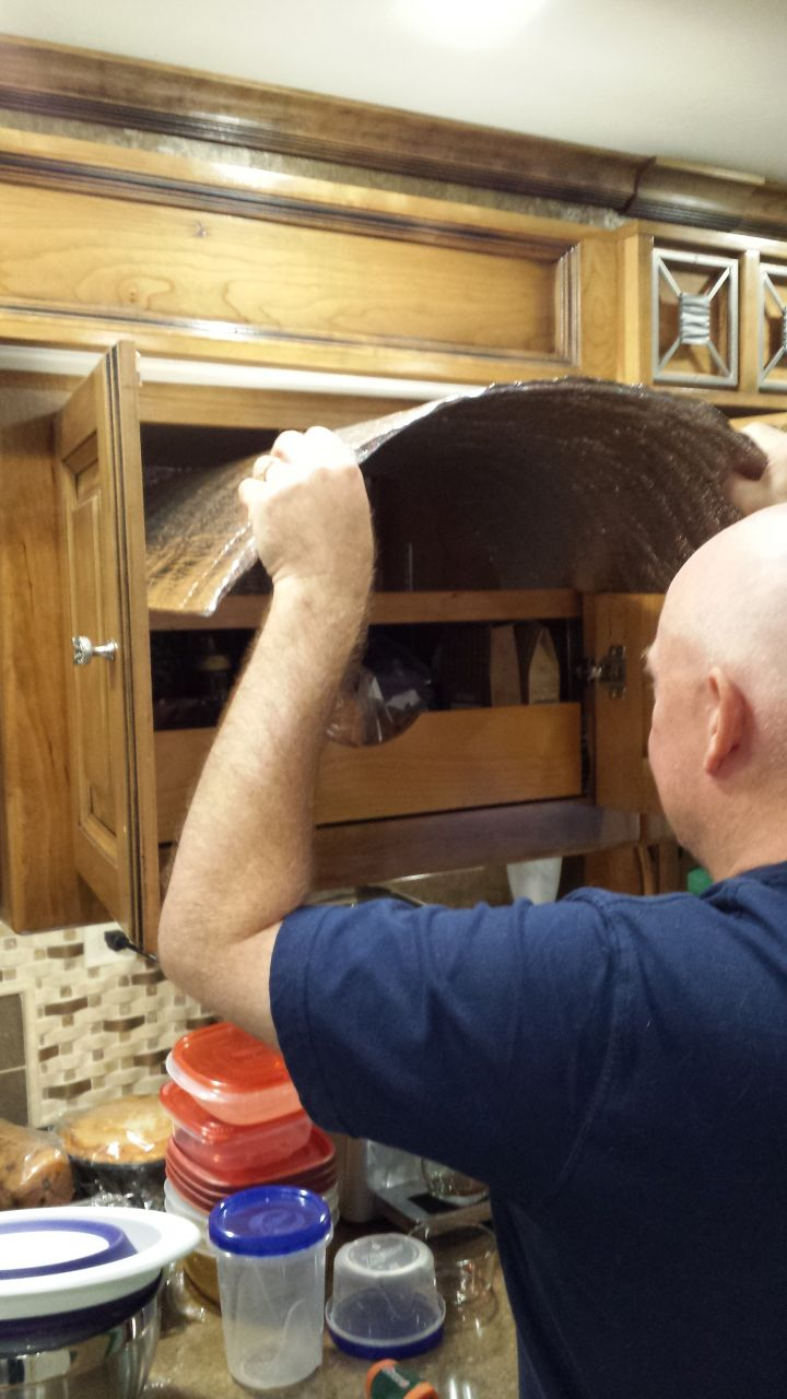 Adding Insulation To The Ceiling Of The Cupboards
