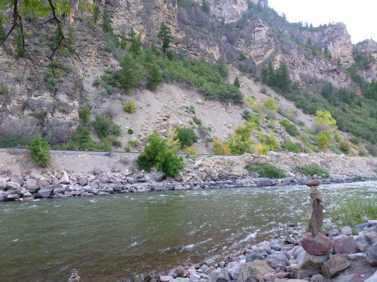 The River Runs Along The Lower Part Of The Campground