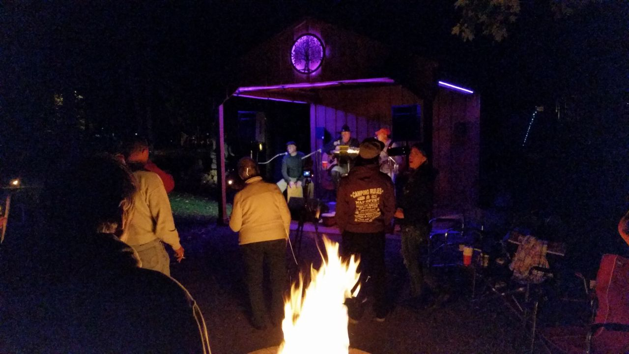 Everyone Enjoying The Campfire And The Band