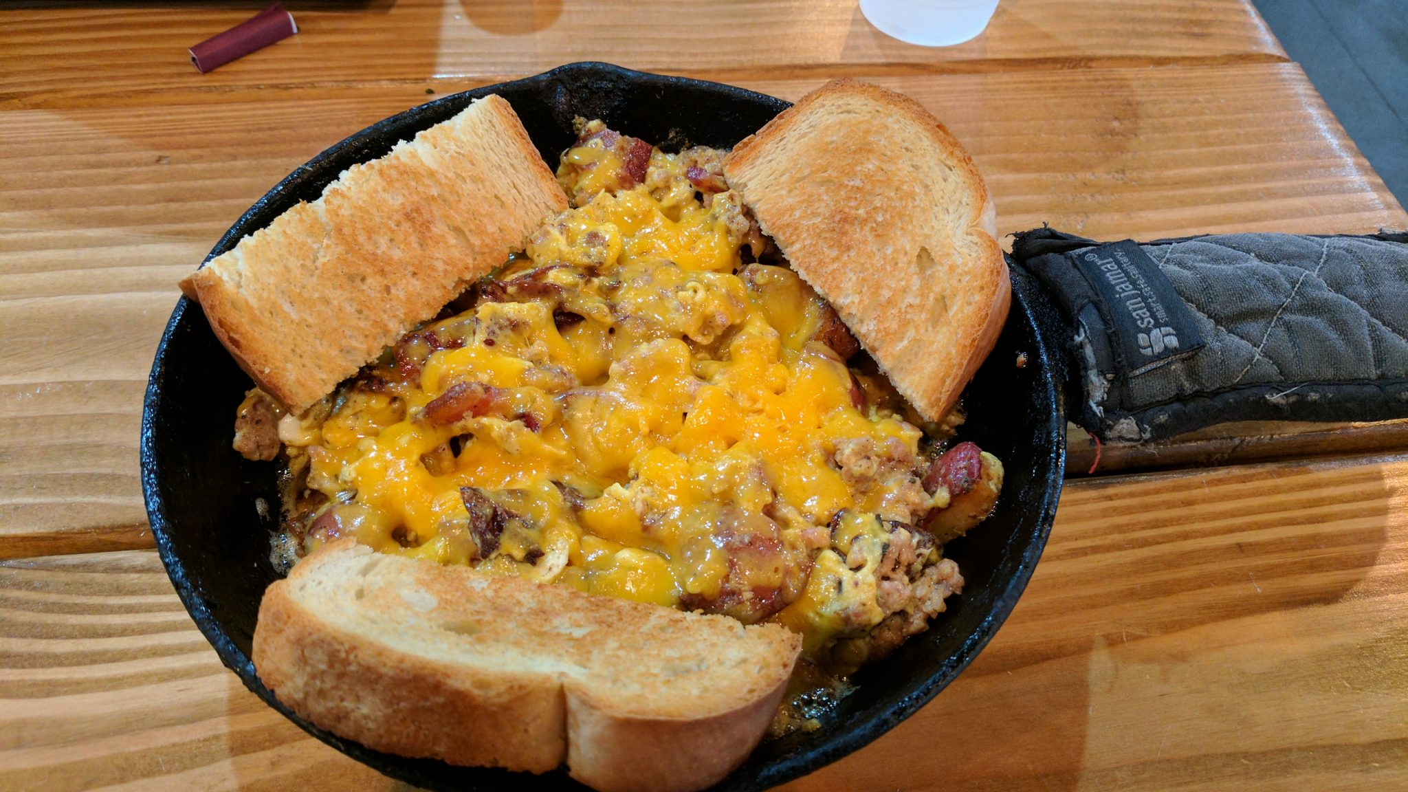 Meat Skillet With Scrambled Eggs And Sour Dough Toast